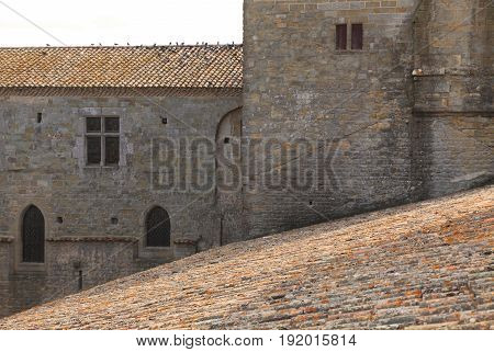Image of roofs and wall in Carcassonne fortress.Carcassonne is a very famous fortified medieval town located in the Languedoc-Roussillon (Aude department) region in the South of France.