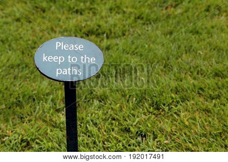 Sign In A Grass Lawn Saying