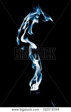 Blue flame of fire on a black background .