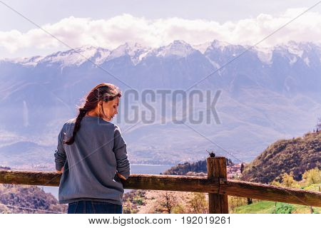Outdoor lifestyle image, portrait of pretty girl posing at amazing mountains background
