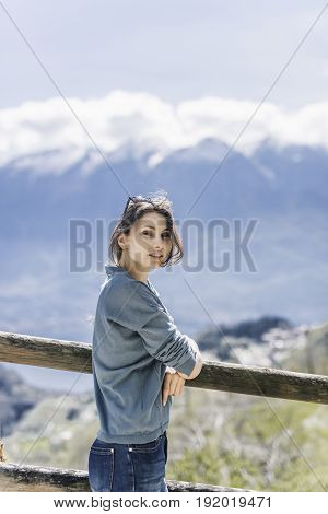Outdoor lifestyle image, portrait of pretty woman posing at amazing mountains background