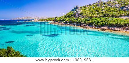 Emerald green sea water and rocks on coast of Maddalena island, Sardinia, Italy.
