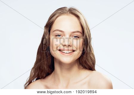 Woman with a smile, woman on a light background portrait.