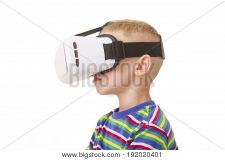 A young boy with VR Goggles with an isolated on white background with clipping mask