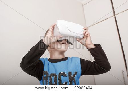 A young boy with VR (Virtual Reality) Goggles or Glasses