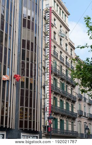 BARCELONA, SPAIN - MAY 2017: Architecture of Barcelona town with big thermometer mounted on a wall of building