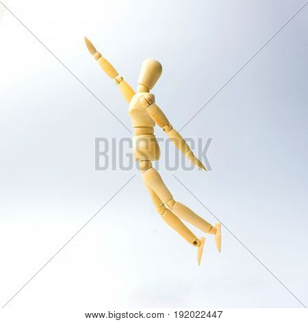 Wooden figure doll with jumping to grap emotion for success business concept.