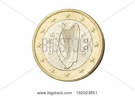 Irish coin of one euro closeup with Celtic harp traditional symbol of Ireland. Isolated on white studio background.