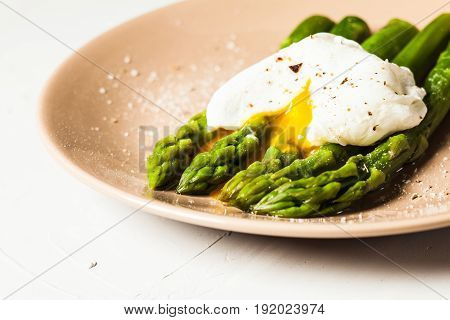 Green boiled Asparagus with Poached Egg, with salt and spices