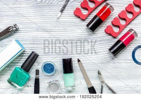 manicure and hands care set with nippers, cuticle scissors on light wooden table background top view mockup