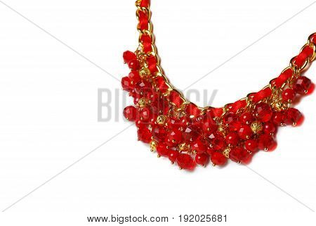 Beautiful red necklace and bracelet on a mannequin in front of white background