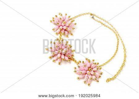 Beautiful pink necklace on a mannequin in front of white background