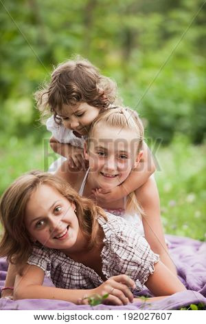 Happy family on green grass in the garden