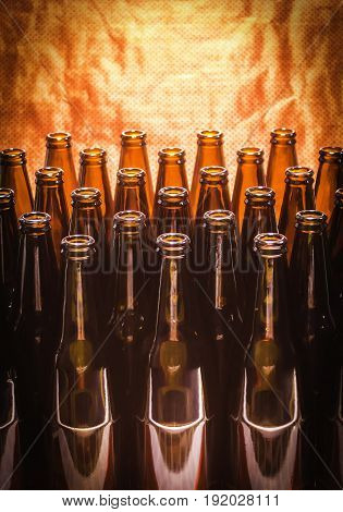 Rows of brown color empty bottles beer