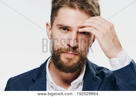 Businessman thoughtful, businessman holds a forehead, businessman on a light background portrait.