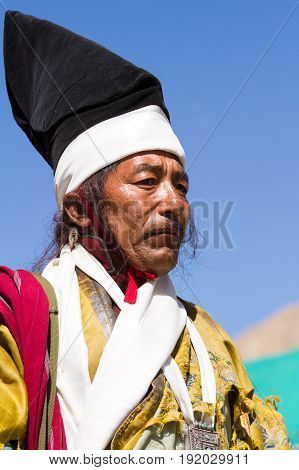 Leh Jammu and Kashmir India - Sep 01 2012: The Ladakhi Man in Traditional Clothing with The Familiar Hat That Is Found Only In Ladakh on the traditional Ladakh festival on sunny day on Sep 01 Leh Jammu and Kashmir India