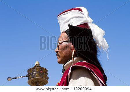 Leh, Jammu And Kashmir, India - Sep 01, 2012: A Ladakhi Man With Hand Prayer Wheel In Traditional Cl