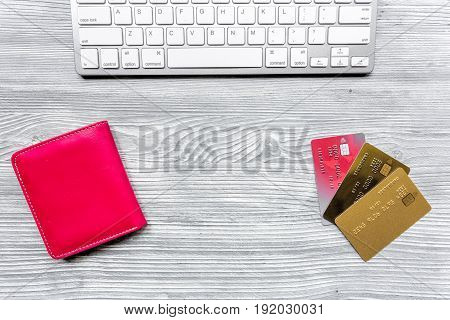 making purchase with credit cards and pink wallet on office desk background top view mockup