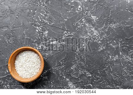 rise in bowl for paella on dark kitchen desk background top view mock-up