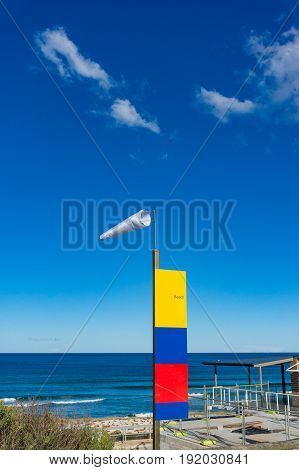 Windsock On The Beach Against Sunny Blue Sky On The Background