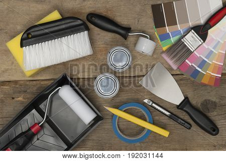Paint Swatches And Home Improvement Painting Equipment On Wooden Surface