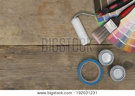 Paintbrush, Roller, Swatches, Tape, And Paint Cans With Copy Space