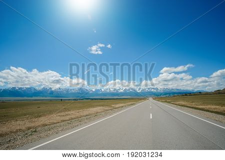 High Angle View Of Road Leading To Mountains