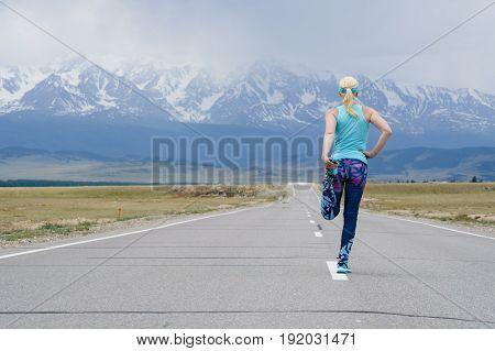 Running Stretching - Female Runner Jogging Before Doing Leg Stretching.