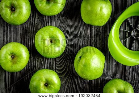 green apples close up pattern on dark wooden desk background top view