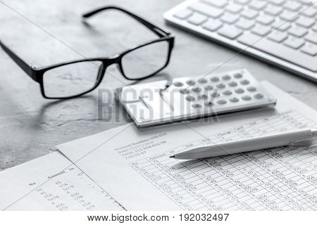 business accounter work with taxes and calculator on office desk background