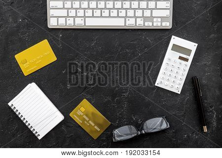savings, finances and economy set for accountant or banker notebook and credit cards on dark table background top view mock up