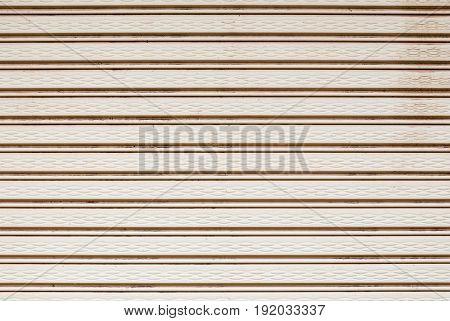 Closeup to Light Brown Metal Shutter Door Background/ Texture