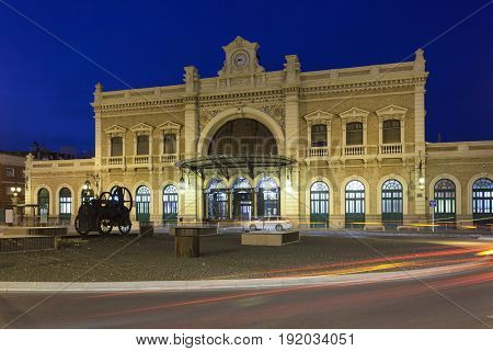 The central station in the city of Cartagena illuminated at night. Region of Murcia Spain