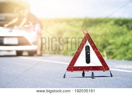 Emergency Stop Sign And Man With Broken Car