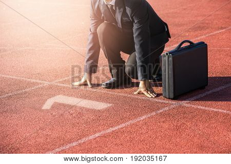 Businessman On A Track Ready For Race In Business