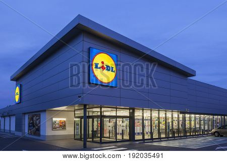 Cartagena Spain - May 17 2017: New Lidl supermarket building illuminated at dusk. Lidl is german discount supermarkets chain based in Neckarsulm Germany