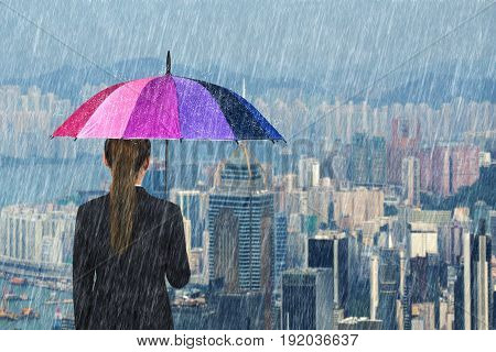 Business Woman Holding Multicolored Umbrella With Falling Rain At City