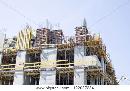 Construction of a high business building with workers