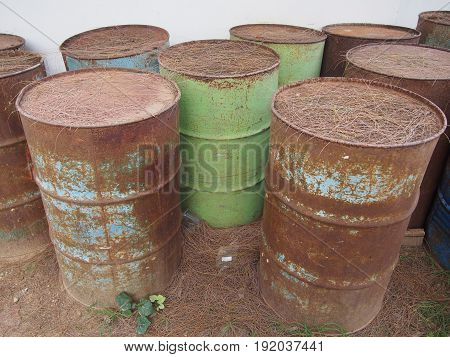 abandoned corroding rusty oil barrels on the ground
