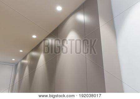 Office Doorway Panel Wall With Overhead Lighting