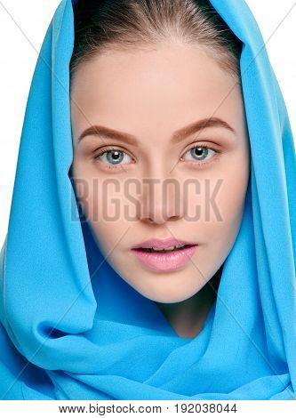 Close up portrait of happy pretty woman with shawl on her head