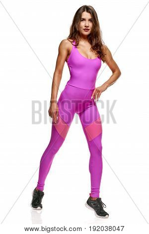 Full length portrait of sporty young woman in pink sportswear
