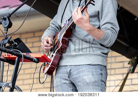 Hands Of Young Musician Playing Electro Guitar During Performance