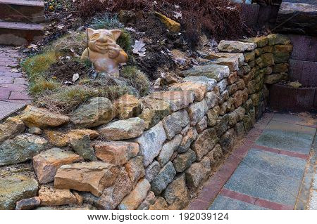 Dry wall without mortar. Wall of stacked stone slabs.