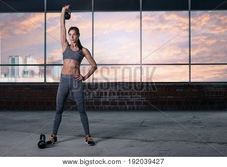 Woman athlete training with weights. Copy space. Fitness concept