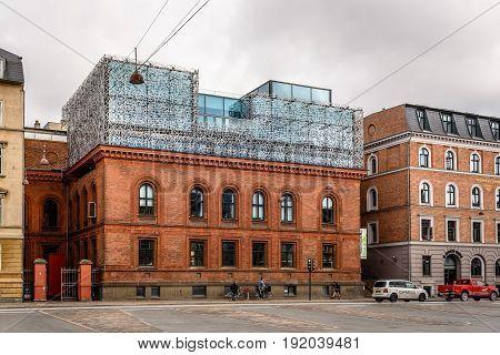 Copenhagen Denmark - August 12 2016. Modern architecture extension of High School in Copenhagen a cloudy day of summer.