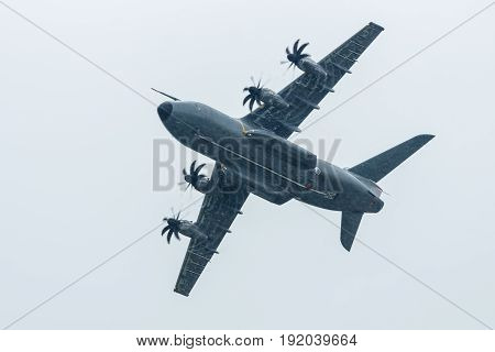 BERLIN GERMANY - JUNI 01 2016: Demonstration flight at rainy day of the military transport aircraft Airbus A400M Atlas. Exhibition ILA Berlin Air Show 2016
