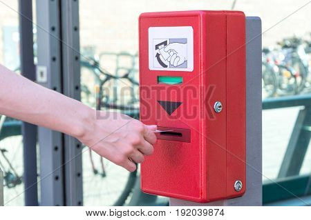 Validate A Ticket At A Red Ticket Validation Machine For The Underground