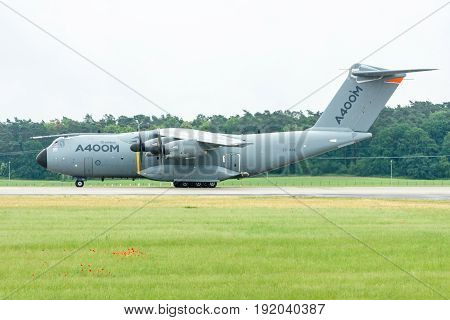BERLIN GERMANY - JUNE 01 2016: Preparing for takeoff military transport aircraft Airbus A400M Atlas. Exhibition ILA Berlin Air Show 2016