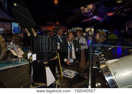 BERLIN GERMANY - JUNE 01 2016: The specialists on the stand of German Max Planck Institute for Extraterrestrial Physics. Exhibition ILA Berlin Air Show 2016